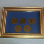 1953-1962 United Kingdom One Penny pieces mounted in frame (1)